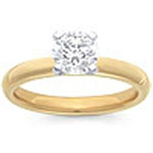 3/4 Carat Brilliant Cut Diamond Solitaire Ring                                 -                                    - Fashioned in 14 karat yellow gold, a single crisp diamond (3/4 ctw) sets itself delicately along the glistening shank in this classic engagement ring.