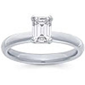 1/2 Carat Emerald Cut Diamond Solitaire                         -                                        Fashioned in 14 karat white gold, a single crisp emerald cut  diamond (1/2 carat (ctw)) sets itself delicately along the glistening shank in this classic engagement ring.