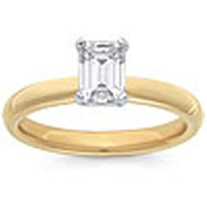 1/2 Carat Emerald Cut Diamond Solitaire                                                            -                          Fashioned in 14 karat yellow gold, a single crisp emerald cut  diamond (1/2 carat (ctw)) sets itself delicately along the glistening shank in this classic engagement ring.