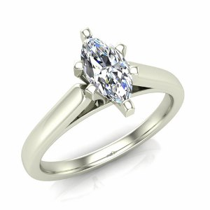 1/3 Carat Marquise Diamond Solitaire - A single 1/3 (ctw) carat Marquise sparkles eminently from a glowing 14 karat white gold cathedral setting in this diamond solitaire engagement ring. Your soon-to-be wife will cherish forever. Also available in white gold.