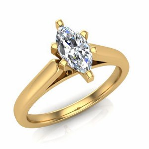 1/3 Carat Marquise Diamond Solitaire - A single 1/3 (ctw) carat Marquise sparkles eminently from a glowing 14 karat yellow gold cathedral setting in this diamond solitaire engagement ring. Your soon-to-be wife will cherish forever. Also available in white gold.