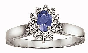 Oval shape 5x3 Tanzanite and 1/10 Carat Total Weight Diamond Ring                            -                    Sleek, modern elegance radiates from this stunning gemstone ring. A luminous 5x3 tanzanite glows in the flowing embrace of lustrous 10 karat white gold. Crisp diamonds add contrast to the fire