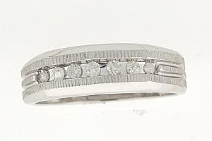 1/4  Carat Total Weight Diamond Band. Band has Channel Set Round Diamonds