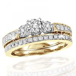 1.50 CTW Diamond Bridal Set with .30CT Center Stone -Three brilliant round diamonds rest radiantly to show your true journey of love of past , present and future from the epicenter of this lavish engagement ring and wedding band set set in cool 14 karat yellow gold and additional crisp diamonds 1.50 carat (ctw) speckle the remainder of the glittering front.Also available in white gold.