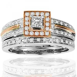 1/2 CTW Diamond Bridal Set - This diamond ring  will leave you enticed for an eternity. Brilliant round  diamonds dominate the gleaming landscape, while 14 karat white gold and a touch of rose gold just adds another dimension to this divinity. Total diamond weight equals  1/2 carats(ctw).Also available in two tone and  yellow gold.