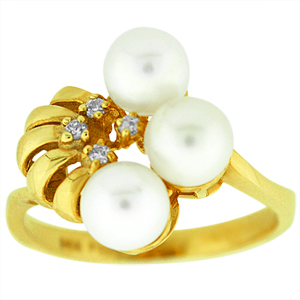 Multiple Pearls and Diamond Ring: This multiple pearl and diamond ring has three 5mm pearls and 4 diamonds to the side. Pearl and diamonds are set in 14 Karat Yellow gold. 
