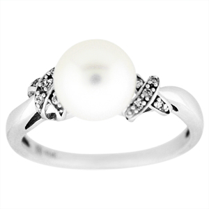 Pearl and Diamond Ring: This Elegant Pearl and Diamond ring is set in 10 Karat White gold. Ring has a 7mm pearl and diamond accents on the side. 