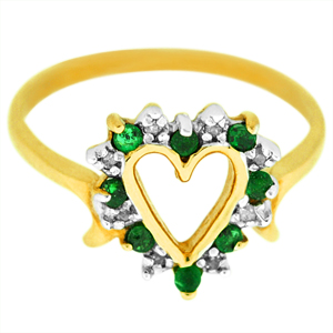 Emerald and Diamond heart shape ring set in 10 karat yellow gold.
