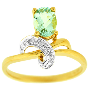 Aquamarine Ring with a 7x5mm Oval Shape Aquamarine and Diamond accents set in 14 Karat Yellow Gold.