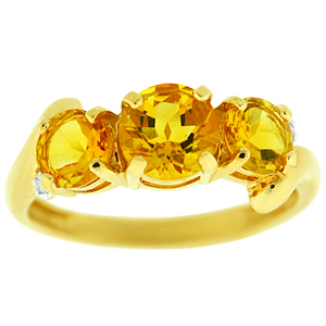 Three stone Citrine Ring: This bold Citrine ring with diamond accents. Ring has a center round Citrine of 6mm and two side Citrine of 5mm each. Stones are set in 14 karat yellow gold ring.