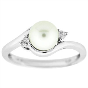 Pearl Ring: This elegant pearl ring has a 6mm pearl and diamond accents on the side. Pearl is set in a 14 karat white gold ring with diamond accents.
