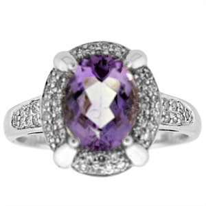 Genuine Amethyst and Diamond Ring with 9x7mm Oval cut Amethyst with 0.25 Carat Total Weight Diamonds set in 14 Karat White Gold Ring.