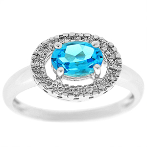 This blue topaz ring with diamonds has a 7x5 mm oval shape blue topaz with round shape diamonds . Diamonds and blue topaz are set in 14 karat white gold. Blue Topaz is also the birthstone for December.