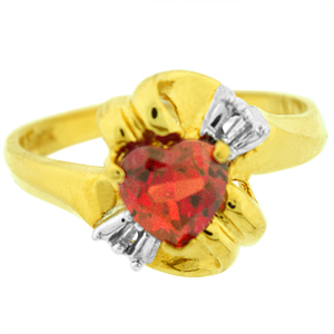 Created Ruby Ring with White Topaz: This ruby ring has a 6mm heart shape created ruby with baguette shape white topaz on the sides. Stones are set in 10 karat yellow gold. Ruby is also birthstone for the month of July.