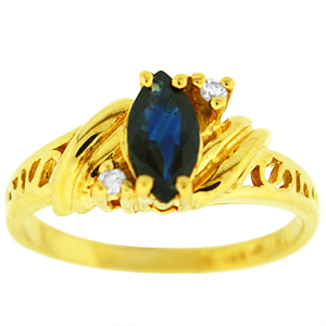 Sapphire Ring with Diamonds: This sapphire ring with diamonds has a 6x4 marquise shape sapphire with two diamonds on the side. Stones are set in 10 Karat yellow gold. Sapphire is also birthstone for the month of September.