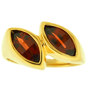 Genuine Garnet Ring: This genuine garnet ring has 2 8x4 marquise shape genuine garnets. These gemstones are set in 10 karat yellow gold. Garnet is also a birthstone for the month of January.