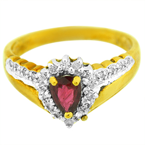 Pear shape genuine Ruby Ring. Ring has 6x4 oval shape Ruby with round diamonds on the side. Ruby and Diamonds are set in 10 karat yellow gold. Ruby is also birthstone for the month of July.