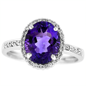 Genuine Amethyst and Diamond Ring with 10x8mm Oval cut Amethyst with 0.10 Carat Total Weight Diamonds set in 14 Karat White Gold Ring.