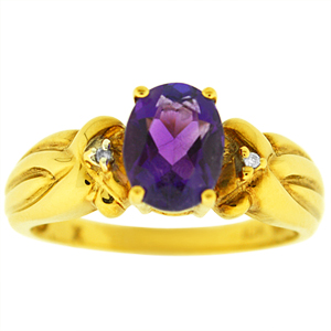 Oval shape genuine Amethyst Ring. Ring has an 8x6 oval shape Amethyst with two diamonds. Amethyst and diamonds are set in 10 karat yellow gold. Amethyst is also birthstone for the month of February. Ring makes a nice gift for any occasion.