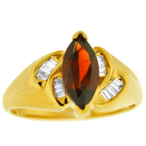 Marquise shape genuine Garnet Ring. Ring has 10x5 marquise shape Garnet with baguette cut diamonds on the side. Diamonds and garnet are set in 10 karat yellow gold.