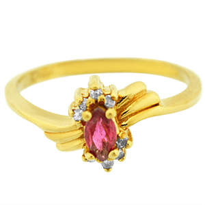 Marquise shape genuine Ruby Ring. Ring has 5x3 marquise shape Ruby with round diamonds on the side. Ruby and Diamonds are set in 10 karat yellow gold. Ruby is also birthstone for the month of July.