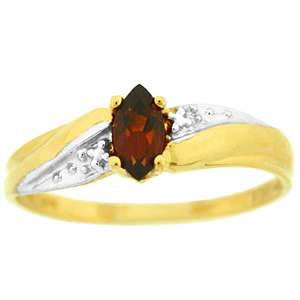 Genuine Garnet Ring: This genuine garnet ring has 5x3 marquise shape genuine garnets. The single gemstone is set in 10 karat two tone gold. Garnet is also a birthstone for the month of January.