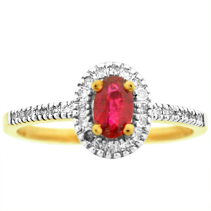 Oval shape genuine Ruby Ring. Ring has 6x4 oval shape Ruby with round diamonds on the side. Ruby and Diamonds are set in 10 karat yellow gold. Ruby is also birthstone for the month of July.