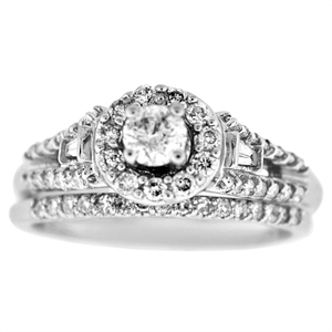 This white gold diamond bridal set has a beautiful diamond engagement ring and diamond wedding ring. Engagement ring has 1/7 carat brilliant cut diamond center surrounded by .60 carat total weight of round brilliant cut diamonds including the wedding band.  All set in 14 karat white gold. Bridal set has a diamond total weight of 0.75 Carat.