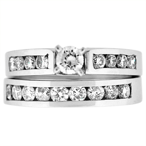 This bold and beautiful yet simple diamond bridal set has diamonds adding up to 1.50 carat. The engagement ring has shining round brilliant cut 0.25 carat center with channel set round diamonds on the shank. Wedding band has channel set shinning round brilliant cut diamonds.  Diamond bridal set is set in high polished 14 karat white gold.