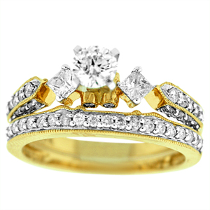 This beautiful yellow gold diamond bridal set has a diamond engagement ring and diamond wedding ring. Engagement ring has 0.40 carat round brilliant cut diamond center with two princess cut diamonds on the side and round diamonds on the shank. Bridal set has diamond carat total weight of 1.25 carats including the wedding band.  Diamond bridal duo is set in 14 karat yellow gold setting.