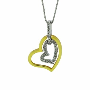 This beautiful dangling heart diamond pendant has 1/4 carat total weight diamonds. Diamonds are set in 10 Karat two tone gold with 18
