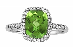 8x6 Peridot  and 0.14 Carat Total Weight Diamond Ring- This rich and feminine gemstone ring features a magnificent 8x6 cushion cut peridot set in gleaming 14 karat white gold. Delicate diamonds add an elegant finishing touch.