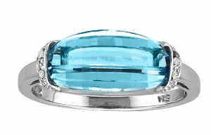 12x6 BLUE TOPAZ RING- This blue topaz ring with diamonds has a 12x6 rectangle shape blue topaz with round shape diamonds on side. Diamonds and blue topaz are set in 10 karat white gold. Blue Topaz is also the birthstone for December.