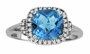 0.20 CTW Diamond and 7mm Cushion Cut Blue Topaz Ring- This blue topaz ring with diamonds has a 7mm square blue topaz with round shape diamonds on side. Diamonds and blue topaz are set in 14 karat white gold. Blue Topaz is also the birthstone for December.
