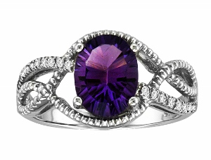 9x7 oval shape Amethyst with 0.08c.t.w diamonds--Oval shape genuine Amethyst Ring. Ring has an 9x7 oval shape Amethyst with 0.08c.t.w diamonds. Amethyst and diamonds are set in 10 karat white gold. Amethyst is also birthstone for the month of February. Ring makes a nice gift for any occasion.