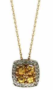 0.10 c.t.w Diamond and Yellow Sapphire Pendant with chain--This rich and feminine gemstone pendant features a magnificent multi stone yellow sapphire set in gleaming 10 karat yellow gold. Delicate diamonds add an elegant finishing touch.