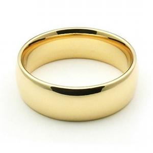 7mm Mens Comfort fit Wedding Band  -- Have all the right moves by offering her this divine ladies wedding band. Invigorated with 14 karat yellow gold, this ring signifies that the first step to eternal happiness starts here.