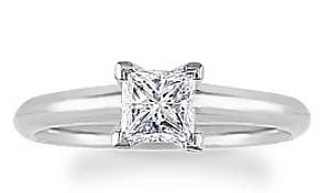 1/2 Carat Princess Cut Diamond.Solitaire Fashioned in 14 karat white gold, a single crisp princess cut diamond sets itself delicately along the glistening shank in this classic engagement ring.
