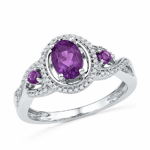 0.20 CTW Diamond and 0.82 CTW Amethyst Ring-- Amethyst and diamonds are set in 10 karat white gold. Amethyst is also birthstone for the month of February. Ring makes a nice gift for any occasion.