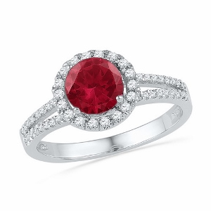 0.27 CTW Diamond and 1.30 CTW Lab Created Ruby Ring -- A 1.30 ct Ruby is surrounded by 0.27ct round diamonds. Ruby and Diamonds are set in 10 karat white gold. Ruby is also birthstone for the month of July.
