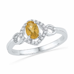 0.10 CTW Diamond and 0.40 CTW Lab Created Citrine Ring -- This citrine and diamond ring has a oval shape lab created 0.40 ct citrine surrounded by 0.10 carat total weight diamonds. Stones are set in 10 Karat White Gold. Nice gift for any occasion.