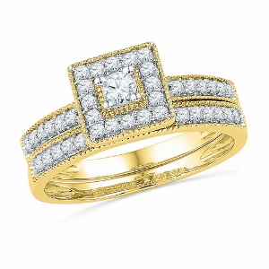 0.50 CTW DIAMOND FASHION BRIDAL SET-This gloriously bold 10K yellow gold diamond engagement ring speaks straight from the heart.  With a dazzling display of brilliance totaling 1/2ct., the ring celebrates your love and the promise of your future together.