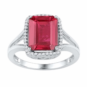 0.15 ctw Diamond and 4.50 ctw Lab Created Ruby Ring--A 4.50 ct Ruby is surrounded by 0.15ct round diamonds. Ruby and Diamonds are set in 10 karat white gold. Ruby is also birthstone for the month of July.