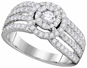 0.99CTW DIAMOND BRIDAL RING.Expressing your unconditional love for her, this beautiful bridal set is brightened by diamonds totaling 0.99 cts. On your wedding day, complete the ensemble by adding the simple-yet-stunning diamond-lined wedding band. Say