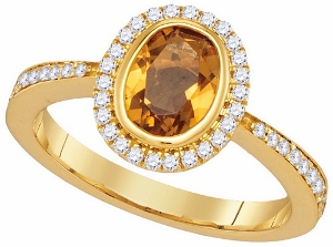 0.29CTW DIAMOND 0.95CTW CITRINE RING-: This citrine and diamond ring has a  oval shape genuine citrine surrounded by 0.29 carat total weight diamonds. Stones are set in 14 Karat Yellow Gold. Nice gift for any occasion.