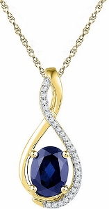0.05 c.t.w Diamond with 1.60 c.t Lab created  Blue Sapphire in 10 Karat Yellow Gold with chain.