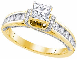 1.25 c.t.w. Diamond Engagement Ring with 0.50 c.t. Princess Center in 14 Karat Yellow Gold.Dazzling brilliant round diamonds play second fiddle to a glorious Princess stone in this breath taking 14 karat Yellow gold ring she will cherish forever. Total diamond weight is 1.25 carats