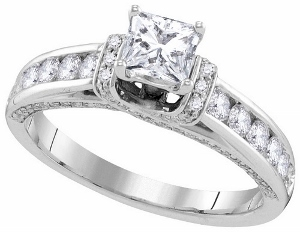 1.25 c.t.w. Diamond Engagement Ring with 0.50 c.t. Princess Center in 14 Karat White Gold.Dazzling brilliant round diamonds play second fiddle to a glorious Princess stone in this breath taking 14 karat White gold ring she will cherish forever. Total diamond weight is 1.25 carats