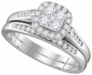 0.50 ctw Diamond Fashion Bridal Set--Round-cut diamonds are the stunning focal point of the engagement ring in this awe-inspiring bridal set for her. Additional set of round diamonds on the band and along the matching wedding band. The set is styled in 14K white gold and has a total diamond weight of 1/2 carat.