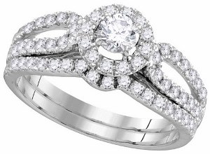 1 c.t.w Diamond Bridal Set With 0.25 c.t.w Center Round Diamond in 14 Karat White Gold.